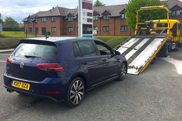 VW Golf with Recovery Truck