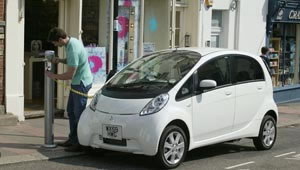 A Mitsubishi i-Miev being powered-up at an EV recharge point