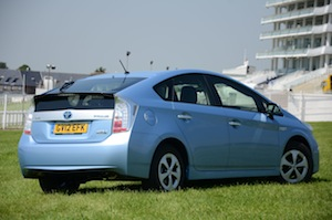 the Prius achieves greater fuel economy and lower emissions than a normal petrol-engined car