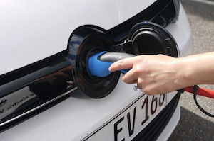 Plugging in to charge the VW Golf Blue-e-Motion